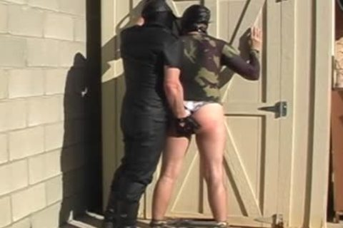 Masked males disrobe And hammer Each Other outside