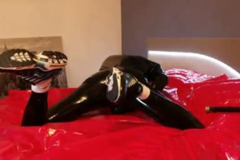 young jerking off In darksome Latex cute Very Very large dong