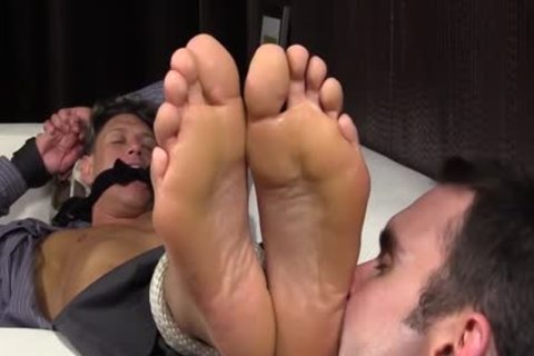 Bryce Evans Is tied Up And Has His Toes Licked On The bed