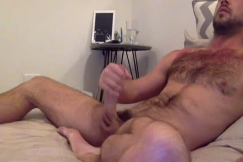 brunette hair hairy lad Strokes His monstrous penis'