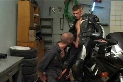 Biker banging Car Mechanic