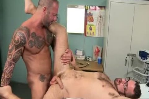 Hunk Tattooed plows A young Doctor