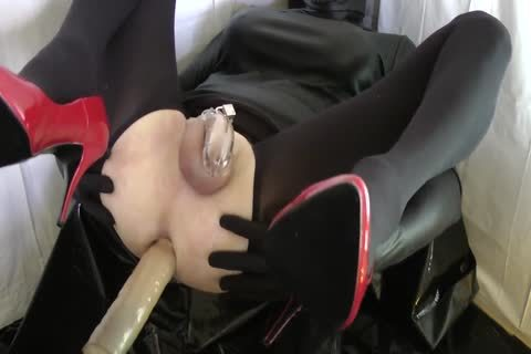 Sissy With Red Heels Is poked In A Chastity Belt