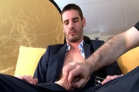 In Suits Straight Male gets Wanked His large knob Despite Of Him.